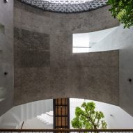 Concrete arch inside of Vom House in Vietnam by Sanuki Daisuke Architects