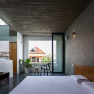 Bedroom of Vom House in Vietnam by Sanuki Daisuke Architects