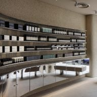 Case-Real contrasts plaster and steel inside Aesop store in Shinjuku