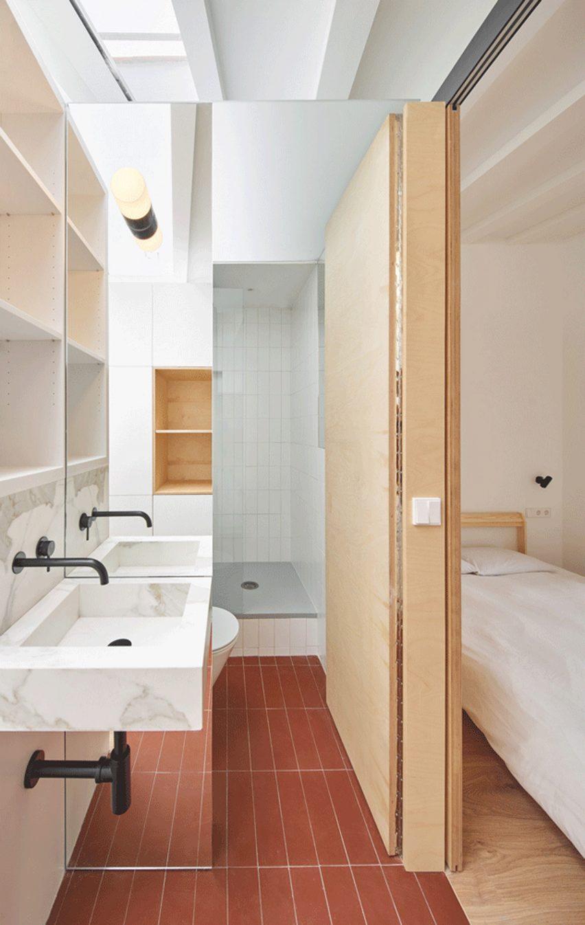 Bathroom with red floor tiles