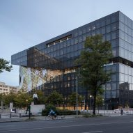 Faceted glass atrium bisects OMA's Axel Springer building in Berlin