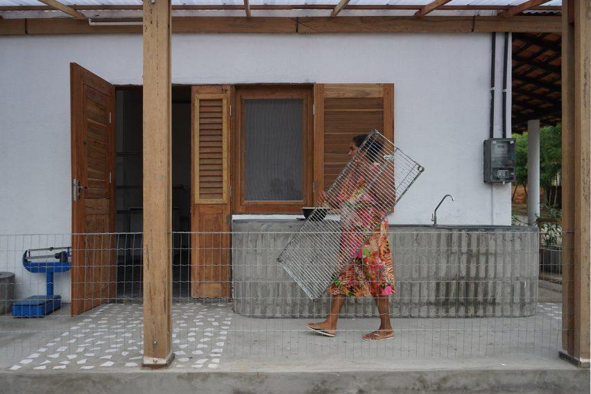 Quebradeira outside Babassu flour factory by Estudio Flume