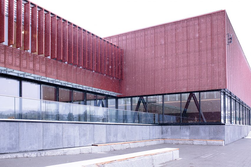 Perforated metal facade of Bølgen Bath and Leisure Centre by White Arkitekter