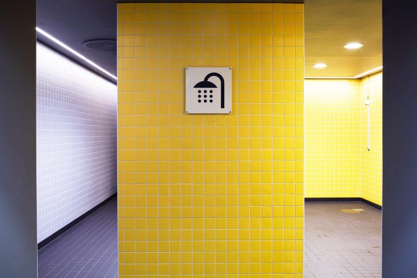 Showers of Bølgen Bath and Leisure Centre by White Arkitekter