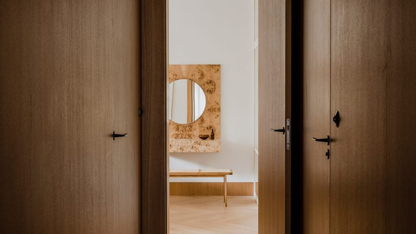 Botaniczna Apartment by Agnieszka Owsiany Studio includes burl wood furniture