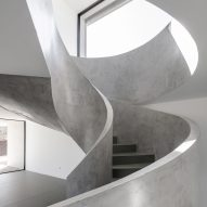 spiral staircase of Canine and feline hotel by Raulino Silva Arquitecto