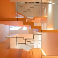 Carlo Ratti unveils digital arts centre with zigzag orange staircase