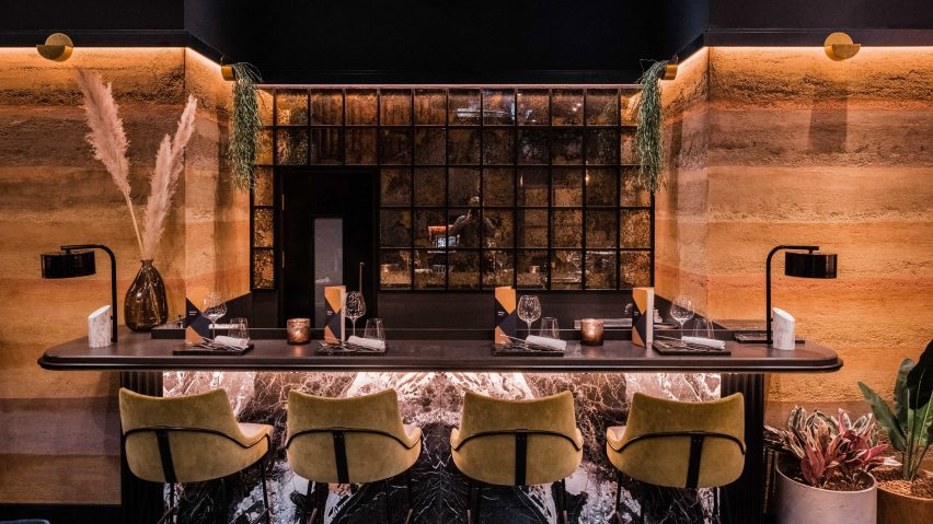 Bar with Rammed Earth Finishes clay plaster walls by Clayworks