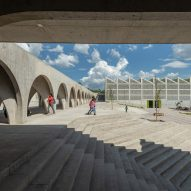 Concrete colonnade links educational facilities at Boys and Girls Club in Mexico