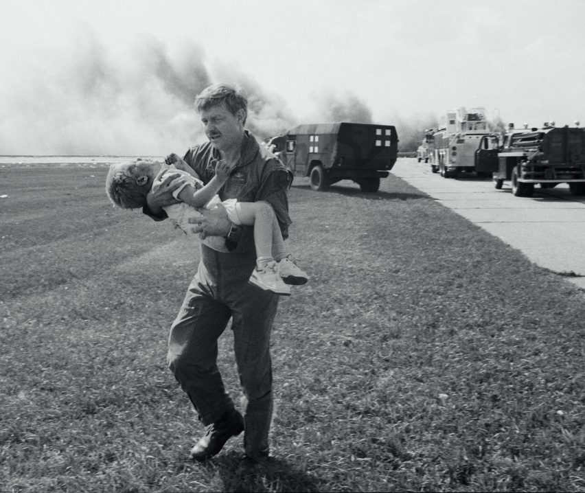 Spencer Bailey being carried after the 1989 crash-landing of United Flight 232 in Sioux City, Iowa, USA