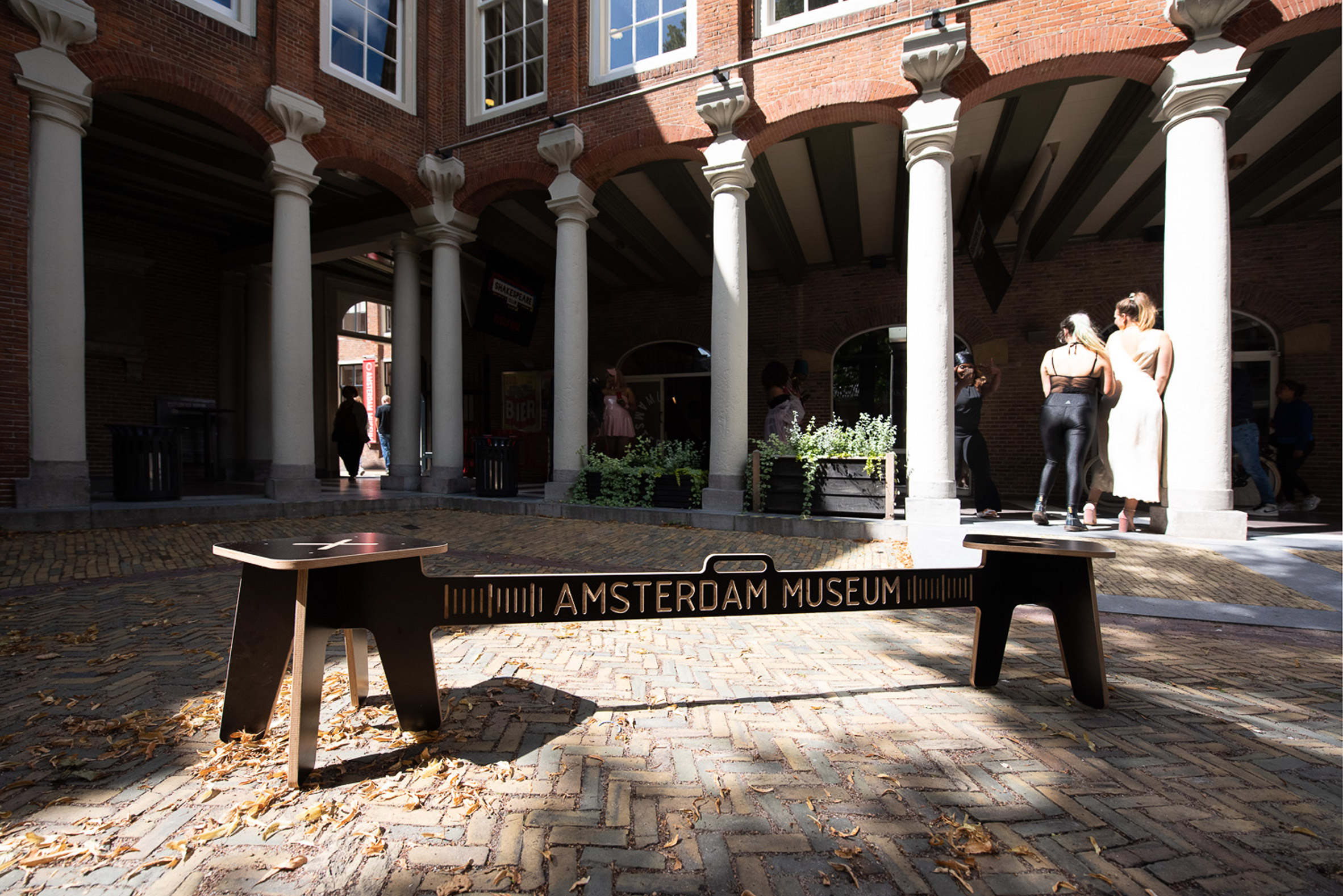 Corona Crisis Kruk, a social distancing bench by Object Studio, displayed outside a museum