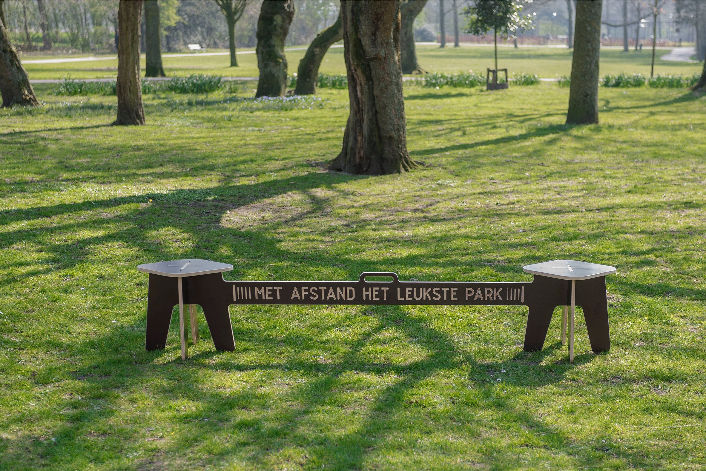 Corona Crisis Kruk, a social distancing bench by Object Studio, in a park in Amsterdam