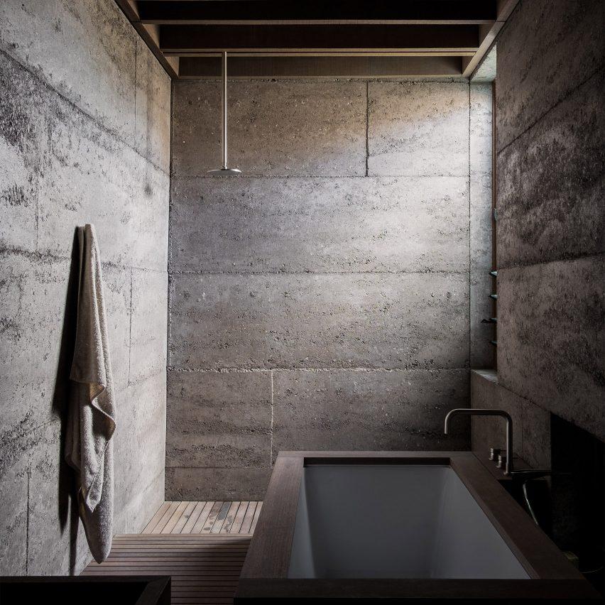 Dark bathroom inside Cloister House, Australia, by MORQ