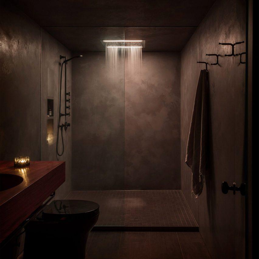 Dark bathroom inside Western Studio, USA, by GoCstudio