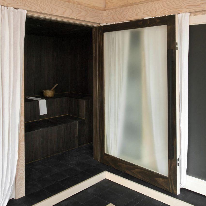 Dark bathroom inside Pioneer Square Loft, USA, by Plum Design and Corey Kingston
