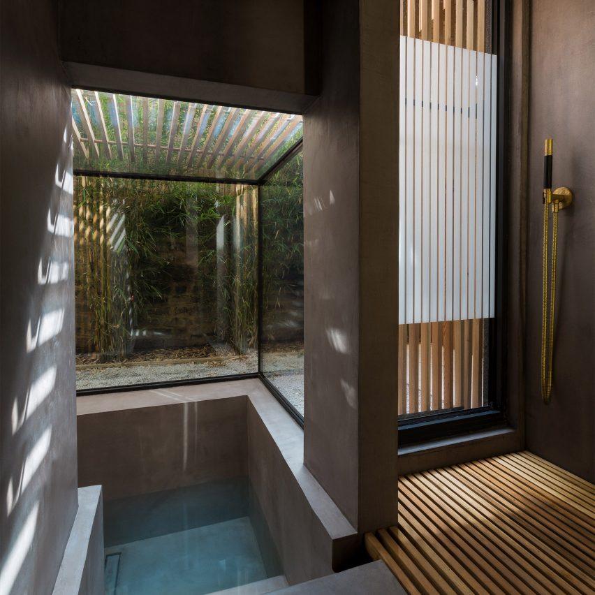 Dark bathroom inside Sunken Bath, UK, by Studio 304