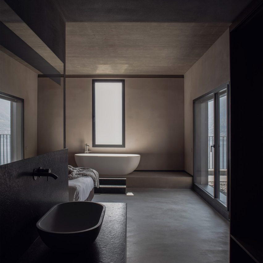 Tranquil Bathrooms With Dark And Soothing Interiors
