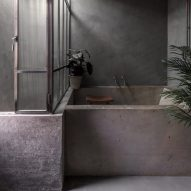 Ten tranquil bathrooms with dark and soothing interiors