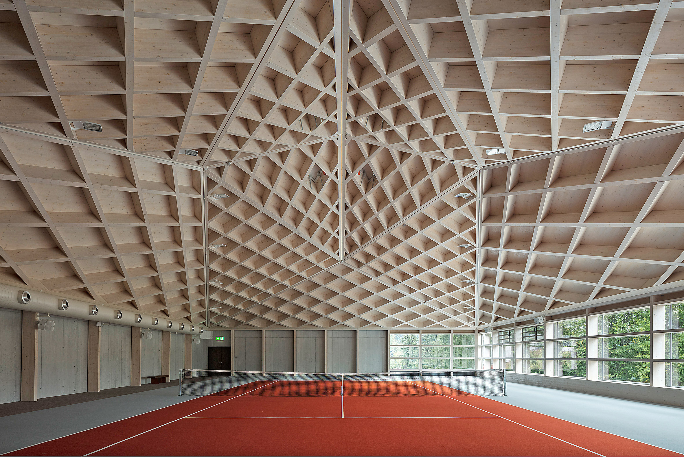 Ceiling of Diamond Domes tennis courts designed by Rüssli Architekten with CLT roofs by Neue Holzbau in the Swiss Alps
