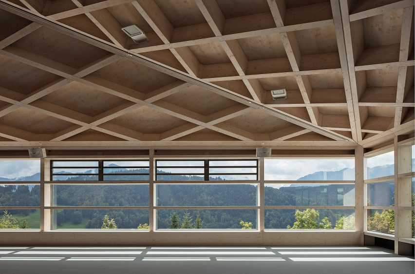Windows of Diamond Domes tennis courts designed by Rüssli Architekten with CLT roofs by Neue Holzbau in the Swiss Alps