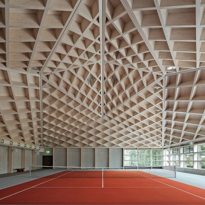 Diamond Domes tennis courts designed by Rüssli Architekten with CLT roofs by Neue Holzbau in the Swiss Alps