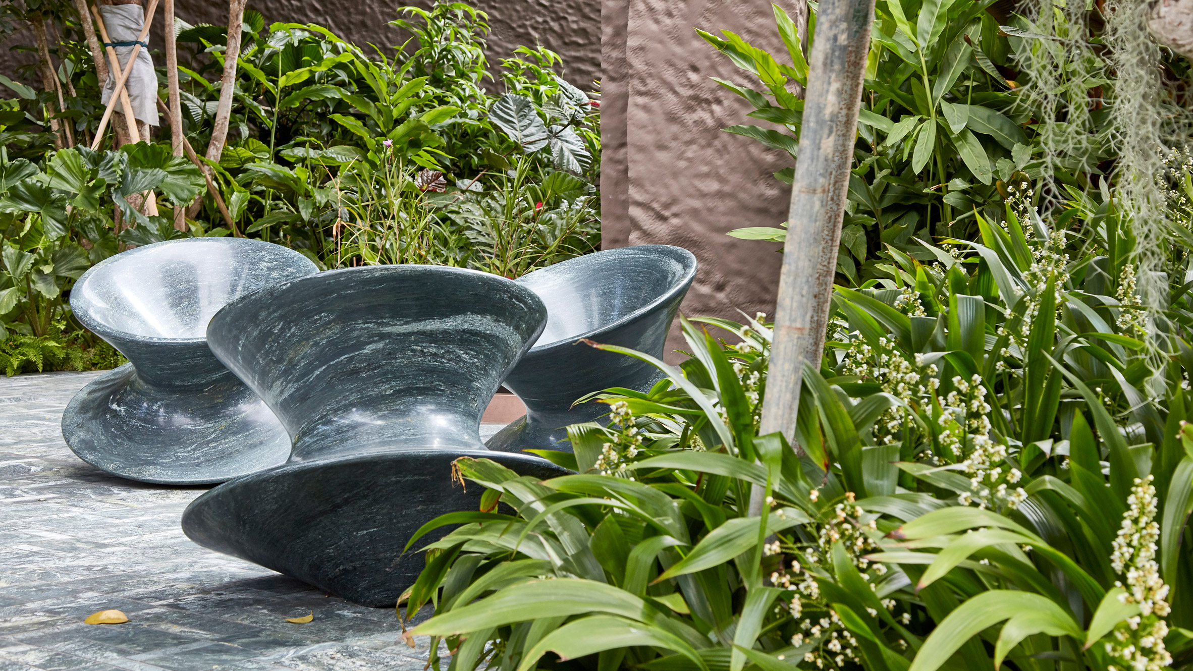 Green granite Spun chairs by Heatherwick Studio