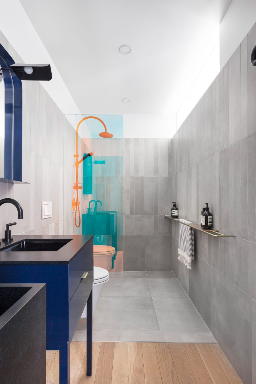 Bathroom with colour-changing shower screens.