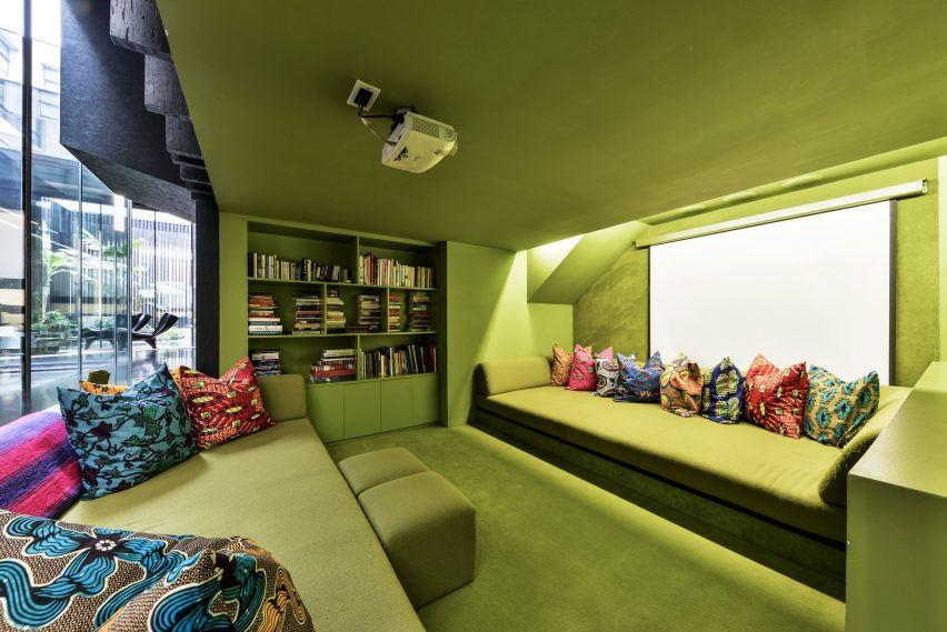 Green sunken cinema room of Lost House by David Adjaye