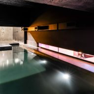 Lost House by David Adjaye features black interiors and bedroom with a pool