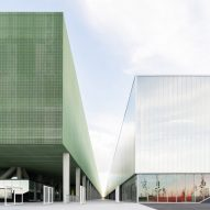MEETT exhibition centre by OMA features perforated green facade