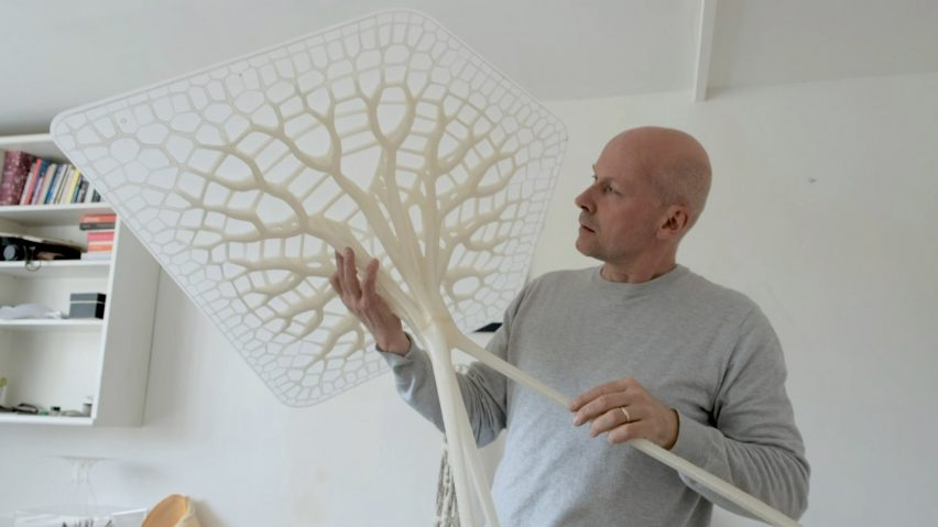 Michael Pawlyn of Exploration Architecture holding Designing With Nature tables