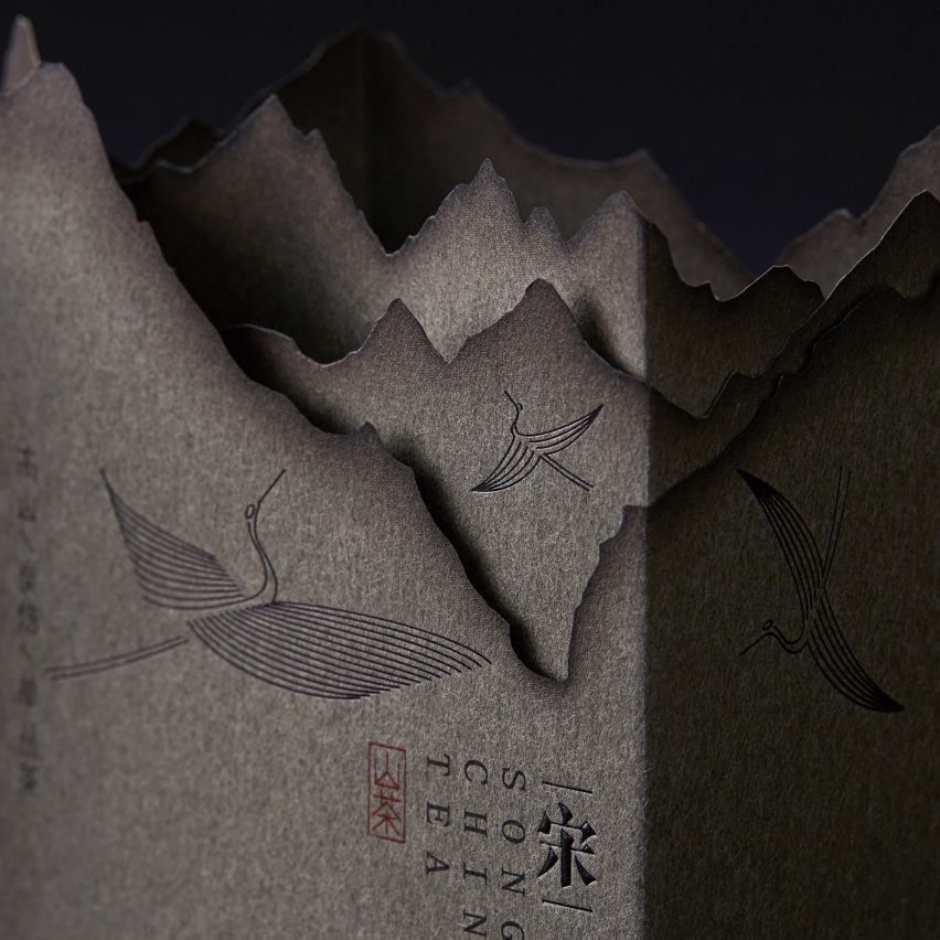Lin Shaobin emulates mountainous scenes with burnt paper for Chinese tea packaging