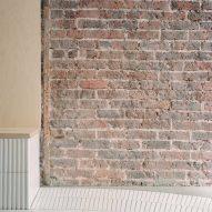 Exposed brick walls feature inside Papi restaurant in Paris