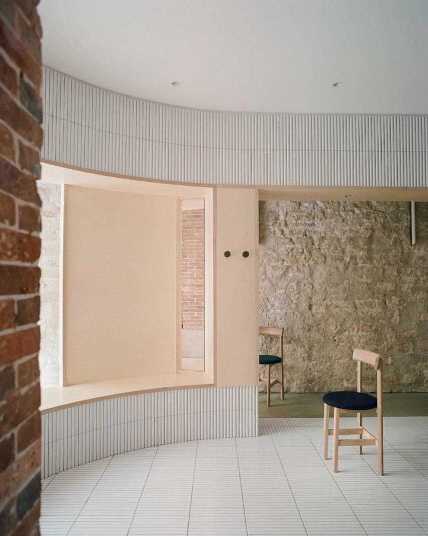 White tiles cover dining area of Papi restaurant in Paris