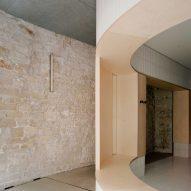 Exposed limestone walls feature inside Papi restaurant in Paris