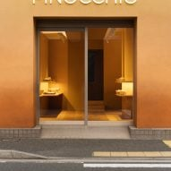 Doorway of Pinocchio tiny bakery in Japan by I IN