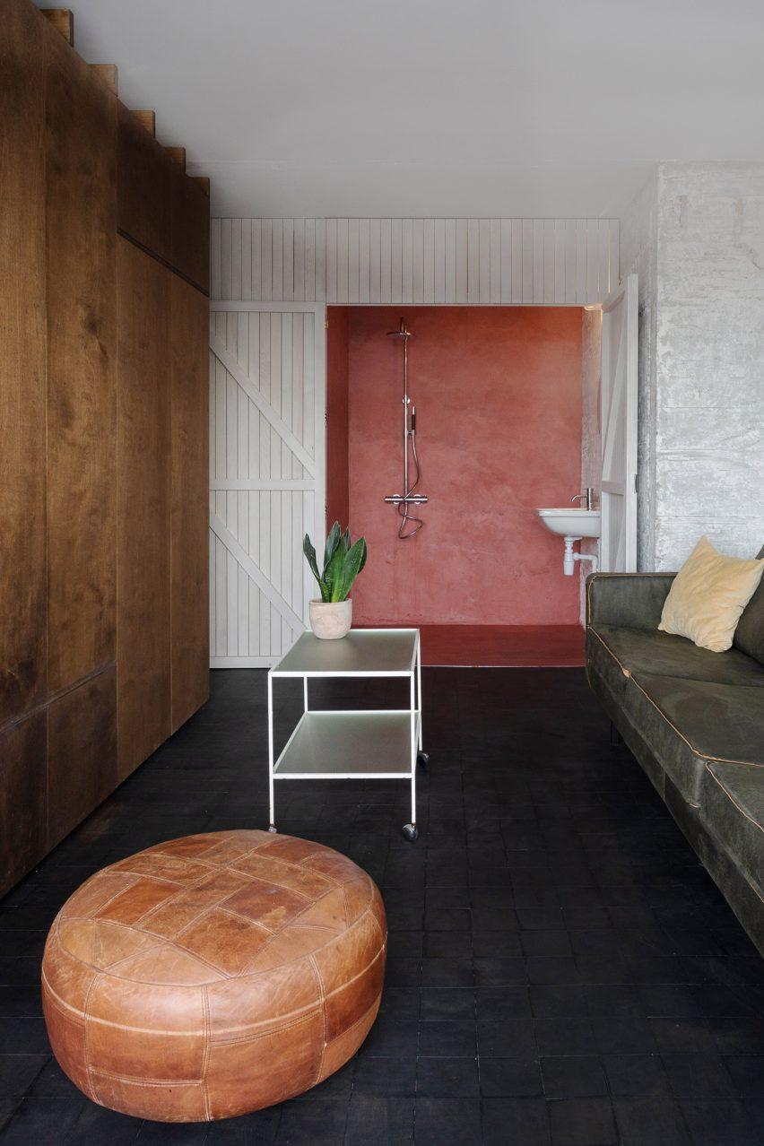 Bathroom with pink walls and barn door