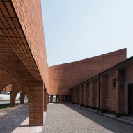 Chinese granaries transformed into art centre with sweeping brick corridors