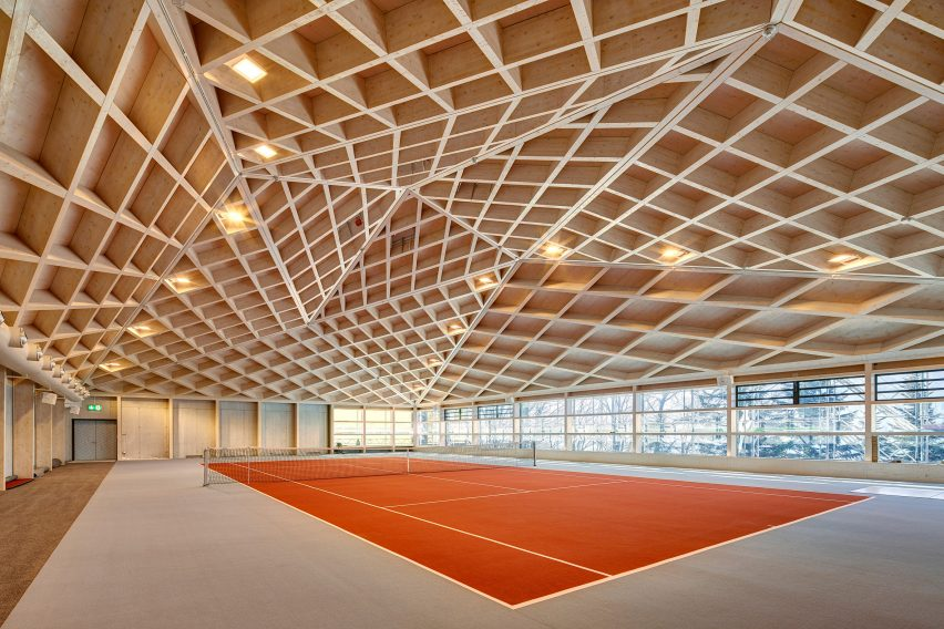 Interior of Diamond Domes tennis courts designed by Rüssli Architekten with CLT roofs by Neue Holzbau in the Swiss Alps