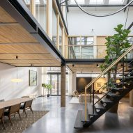 Old gymnasium transformed into lofty apartment in Amsterdam
