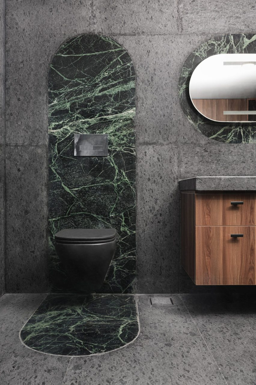 Emerald-coloured marble toilet surround