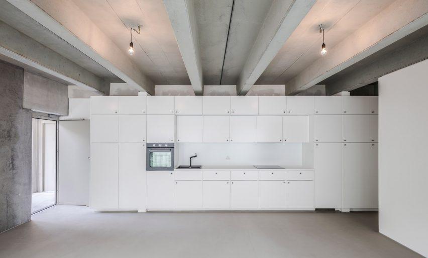 Kitchen in Wohnregal, a prefabricated concrete housing block by FAR in Berlin, Germany