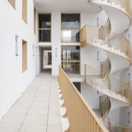 Spiral staircase of Zellige housing in Nantes, France, by Tectône and Tact Architectes