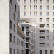 Spiral staircase twists through Zellige apartment complex by Tectône and Tact Architectes