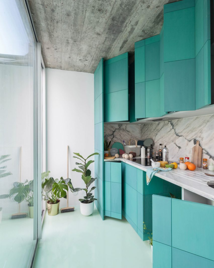 Three colours of minty green kitchen