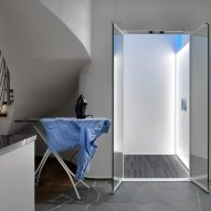 Aritco Homelift by Aritco includes backlit wall that displays artwork