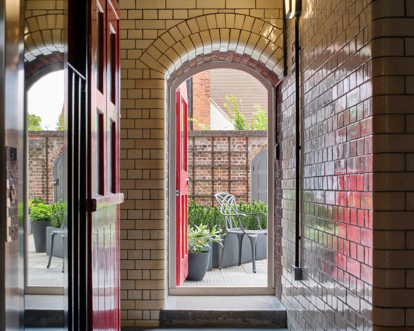 Arched brick doorway of Belsize Fire Station apartments by Tate Harmer, London