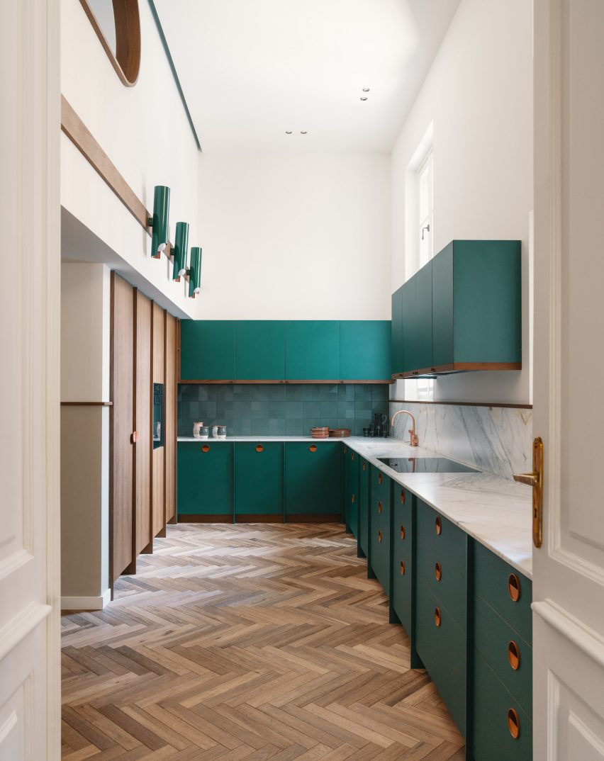 Teal kitchen counter with copper handles