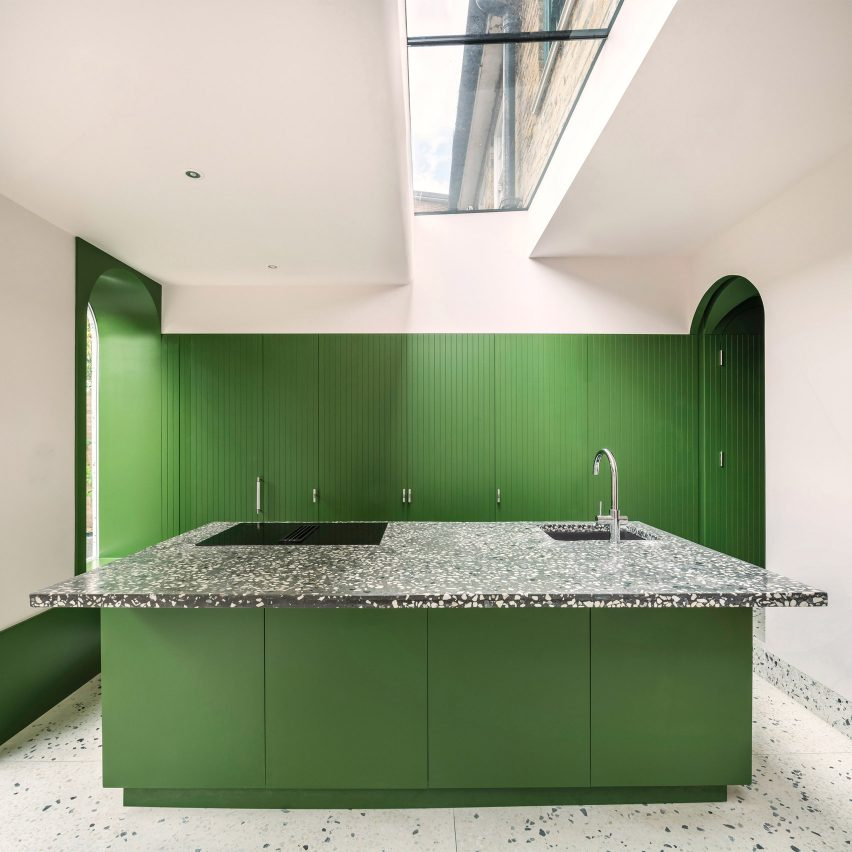 Bright green kitchen with terrazzo detailing