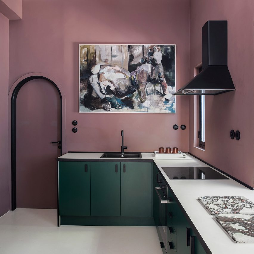 Plum-purple kitchen with green cabinetry